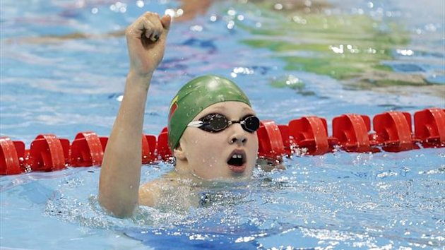Lithuania's Ruta Meilutyte reacts after winning her women's 100m breaststroke final during the London 2012 Olympic Games at the Aquatics Centre (Reuters)