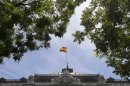 A Spanish flag flies over the Bank of Spain in Madrid