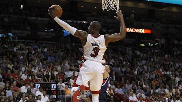 Miami Heat guard Dwyane Wade grabs an offensive rebound against Atlanta Hawks during their NBA game at the American Airlines Arena in Miami (Reuters)