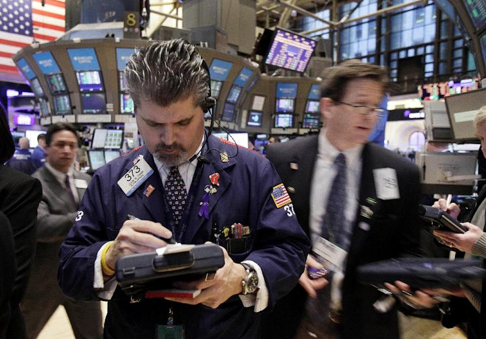 Trader John Panin, center, works on the floor of the New York Stock Exchange Friday, Feb. 3, 2012. U.S. stocks are opening sharply higher after the unemployment rate dropped to the lowest in two years. (AP Photo/Richard Drew)