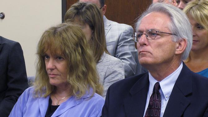 Dr. Ann Kristin Neuhaus watches as the Kansas State Board of Healing Arts decides to revoke her license over referrals of patients she made in 2003 for late-term abortions, Friday, June 22, 2012, in Topeka, Kan. Next to her is one of her attorneys, Bob Eye. The State Board of Healing Arts ratified an administrative judge's earlier decision to strip Dr. Ann Kristin Neuhaus of her license. Neuhaus provided second opinions that Tiller needed under Kansas law to perform some late-term abortions at his Wichita clinic. Tiller, one of a few U.S. physicians known to perform abortions in the final weeks of pregnancy, was shot to death in May 2009 by a man professing strong anti-abortion views.  (AP Photo/John Hanna)