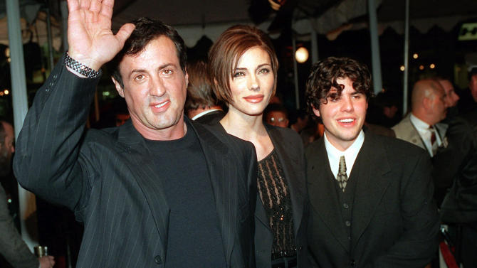 """FILE - In this Dec. 5, 1996 file photo, Sylvester Stallone, left, star of the film """"Daylight,"""" arrives at the film's world premiere with his girlfriend Jennifer Flavin, center, and his son Sage Stallone, who co-stars in the film, in Hollywood district of Los Angeles. A publicist for Sylvester Stallone says the actor's son, Sage Stallone has died on Friday, July 13, 2012, at age 36. (AP Photo/Kevork Djansezian, File)"""