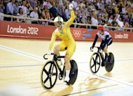 Australia's Anna Meares celebrates after crossing the finish line ahead of Britain's Victoria Pendleton (R) to win the gold medal in the London 2012 Olympic Games women's sprint final cycling event at the Velodrome in the Olympic Park in East London