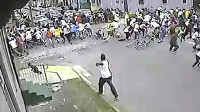The suspect (bottom center) who opened fire at a Mother's Day parade, in New Orleans, May 12.