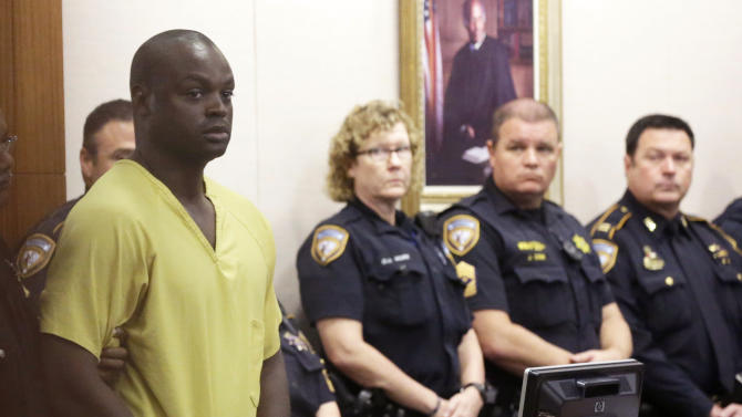 Shannon Miles is escorted into court for a hearing Monday, Aug. 31, 2015, in Houston. Miles has been charged with capital murder in the death of Harris County Sheriff's Deputy Darren Goforth. He is being held without bond. (AP Photo/Pat Sullivan)