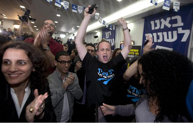 "Supporters of Yair Lapid and his ""Yesh Atid"" party celebrate election results in Tel Aviv, Tuesday, Jan. 22, 2013.  The party, formed just over a year ago, out did forecasts by far and are predicted t"