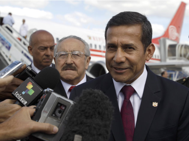 Peru's President Ollanta Humala speaks with journalists after arriving to the Jose Marti international airport in Havana, Cuba, Friday, Jan. 11, 2013. Humala arrived to Cuba to visit Venezuela's Presi