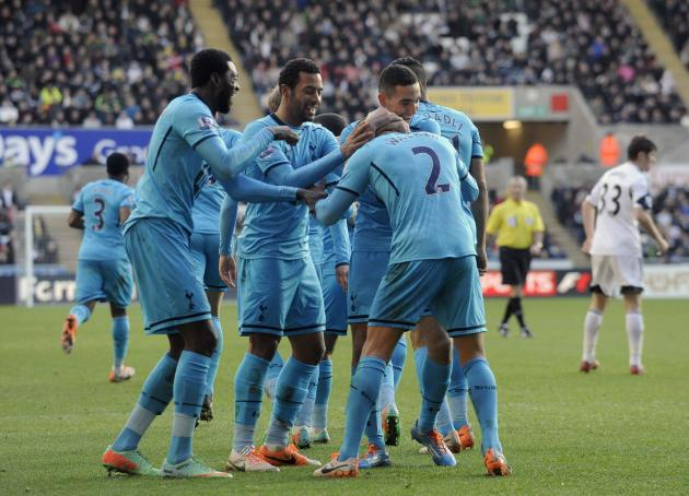 Tottenham Hotspur's Adebayor, Dembele and Bentaleb celebrate with Walker their second goal during their English Premier League match at the Liberty Stadium in Swansea