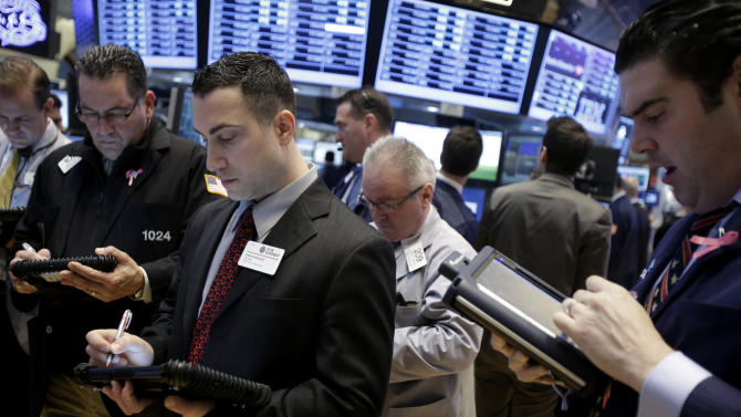 Traders work on the floor of the New York Stock Exchange in New York, Thursday, Jan. 31, 2013.  (AP Photo/Seth Wenig)