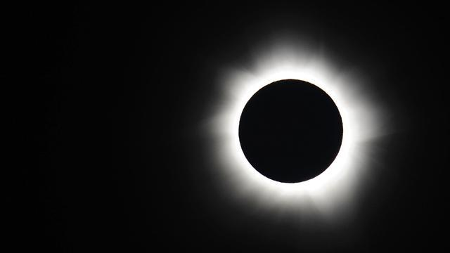 Photos:  Solar Eclipse Darkens S. Pacific