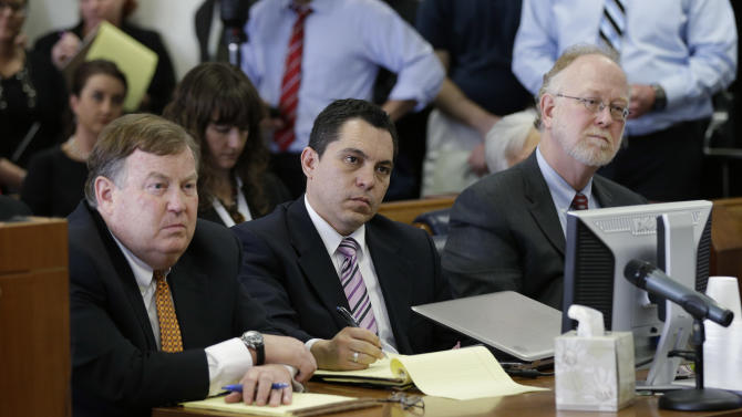 Plaintiff attorneys Rick Gray, left, David Hinojosa, center, and David Thompson, right,  listen to a ruling in a consolidated six-lawsuit case contending the school finance system violates the Texas Constitution, Monday, Feb. 4, 2013, in Austin, Texas. State District Judge John Dietz ruled that he system Texas uses to fund public schools violates the state's constitution by not providing enough money to school districts and failing to distribute the money in a fair way. (AP Photo/Eric Gay)