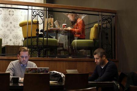 Customers use laptop computers in Starbucks' Vigo Street branch in Mayfair, central London
