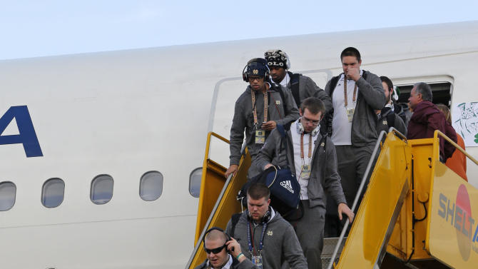 Notre Dame players deplane after arriving in Fort Lauderdale, Fla., Wednesday, Jan. 2, 2013. Notre Dame takes on Alabama in the BCS national championship NCAA college football game next Monday in Miami. (AP Photo/Alan Diaz)