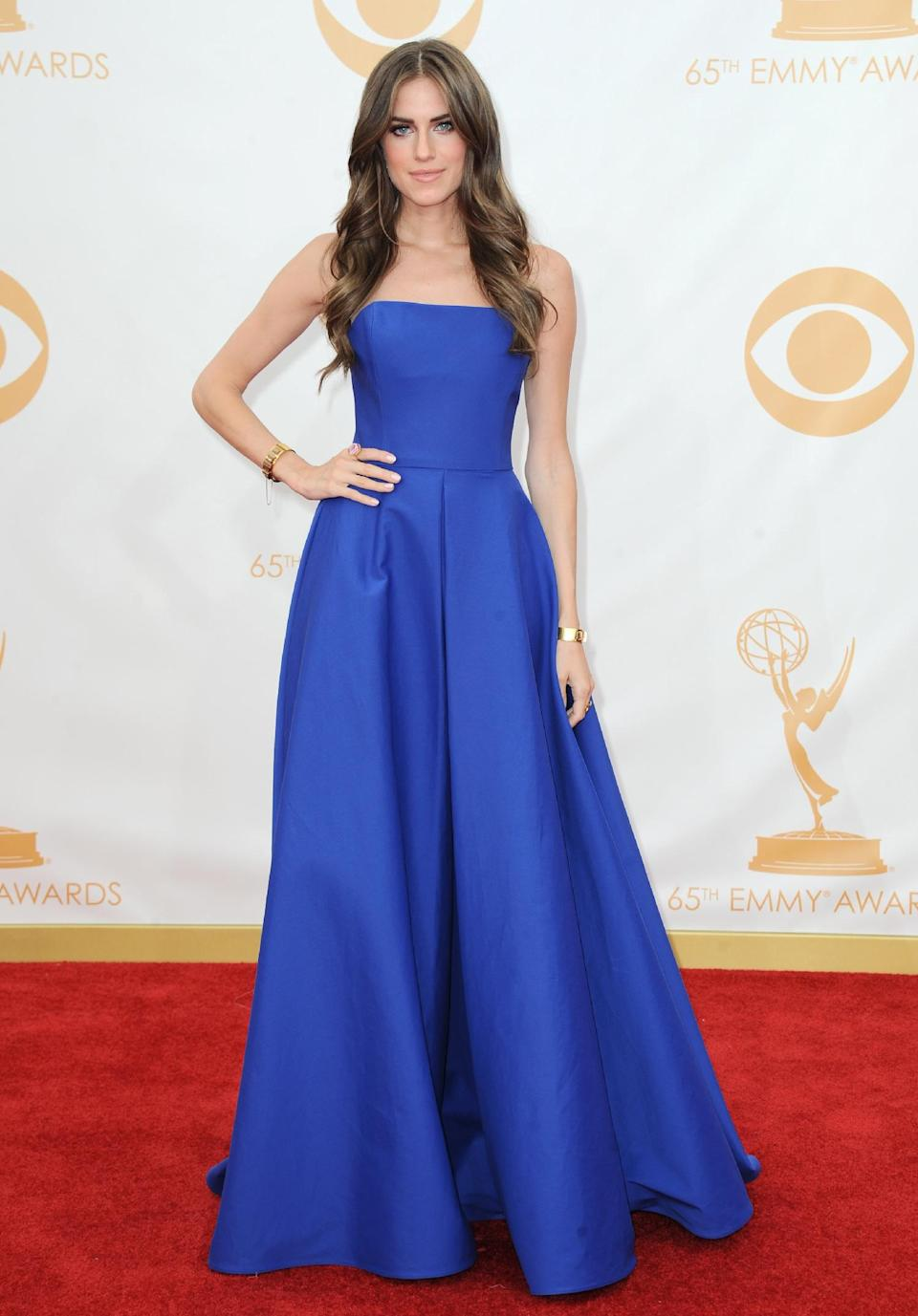 Allison Williams, wearing Ralph Lauren, arrives at the 65th Primetime Emmy Awards at Nokia Theatre on Sunday Sept. 22, 2013, in Los Angeles. (Photo by Jordan Strauss/Invision/AP)