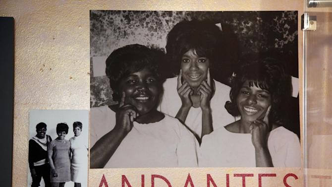 """This March 12, 2013 photo, shows photos of the Andantes, part of the exhibit, """"Motown Girl Groups: The Grit, the Glamour, the Glory""""  at the Motown Historical Museum in Detroit. The Andantes are featured _ with equal billing _ alongside the Supremes, Vandellas, Marvelettes and Velvelettes. (AP Photo/Paul Sancya)"""