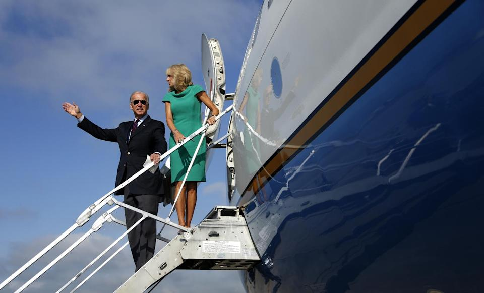 Vice President Joe Biden and his wife Jill Biden board Air Force Two at North Carolina Air National Guard, Friday, Sept. 7, 2012, in Charlotte, N.C., en route to New Hampshire. (AP Photo/Carolyn Kaster)