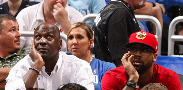 Michael Jordan watches the game against the Orlando Magic with his son ...