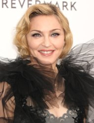 Madonna dedicates Golden Globe-winning song to Elton John
