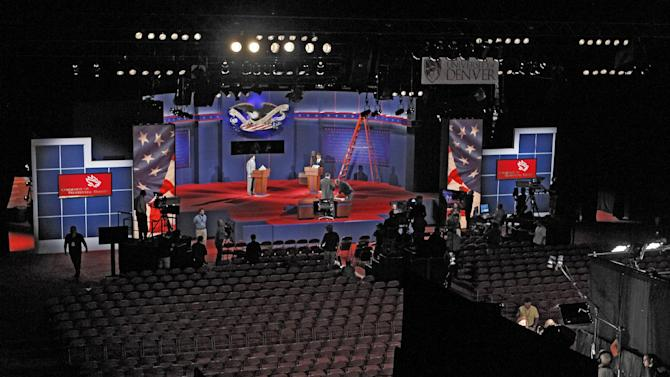 Crews work during a rehearsal at the University of Denver in Denver, Tuesday, Oct. 2, 2012, where the first presidential debate between President Barack Obama and Republican presidential candidate Mitt Romney is scheduled for Oct. 3.  (AP Photo/Ed Andrieski)