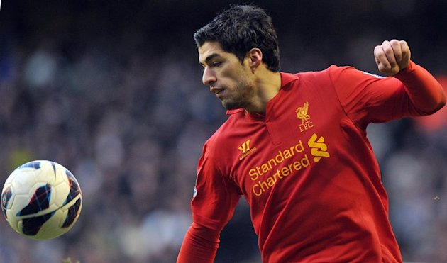 Liverpool's Luis Suarez controls the ball during a league match against Tottenham Hotspur at Anfield, on March 10, 2013