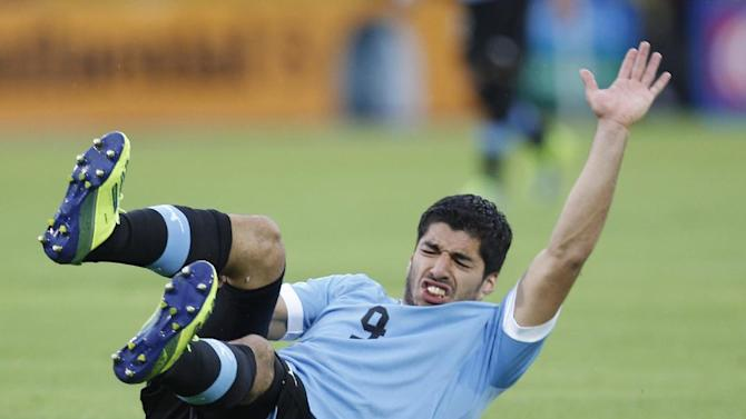 This is a Friday, Oct. 11, 2013 file photo of Uruguay's Luis Suarez, as he reacts after falling during a 2014 World Cup qualifying soccer game against Ecuador in Quito, Ecuador. Uruguay striker Luis Suarez has undergone keyhole surgery on his knee and is expected to recover in time for the World Cup. The mother of the 27-year-old Liverpool striker says he had surgery Thursday May 22, 2014 to repair damage to his meniscus. Sandra Diaz tells The Associated Press that the surgery was successful and that he is expected to recover in 2-3 weeks. Uruguay plays its first match at the World Cup against Costa Rica on June 14. The team will then face England on June 19 and Italy on June 24