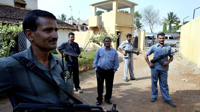 FILE – In this April 15, 2007 file photo, Mahendra Karma, center, lawmaker and founder of Salwa Judum, the government-supported militia to combat Communist rebels known as Naxalites, is surrounded by bodyguards at his residence in Jagdalpur, in the central Indian state of Chattisgarh. Karma was killed when Maoist rebels attacked a convoy of cars of Congress party leaders and supporters in eastern India, injuring several people on Saturday, May 25, 2013. The rebels have been fighting the central government for more than four decades, demanding land and jobs for tenant farmers and the poor. (AP Photo/Mustafa Quraishi, File)