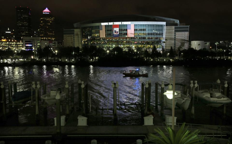 A Coast Guard patrol boat cruises past the Tampa Bay Times Forum in Tampa, Fla., Monday, Aug. 27, 2012. The start of the Republican National Convention, being held at the facility, has been delayed because of the approaching tropical storm Isaac. (AP Photo/Dave Martin)