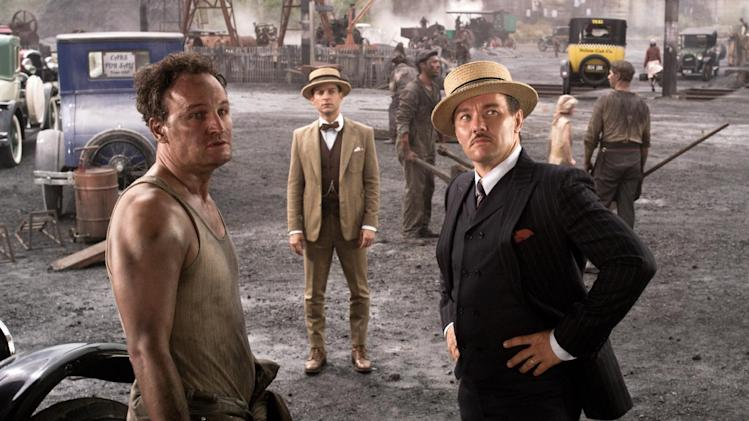 "This film publicity image released by Warner Bros. Pictures shows Jason Clarke as George Wilson, left, Tobey Maguire as Nick Carraway, center, and Joel Edgerton as Tom Buchanan, right, in a scene from ""The Great Gatsby."" (AP Photo/Warner Bros. Pictures)"
