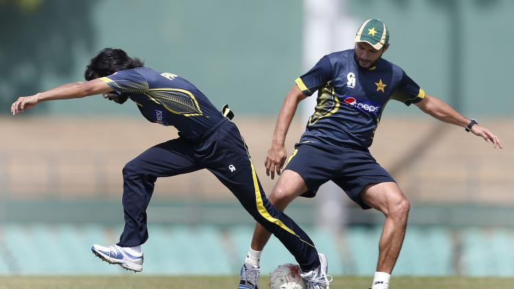 Pakistan's Afridi and his teammate Alam fight for a soccer ball during a practice session ahead of their final ODI cricket match against Sri Lanka in Dambulla