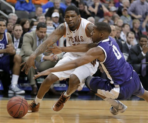 Texas gets past TCU in Big 12 tourney 70-57