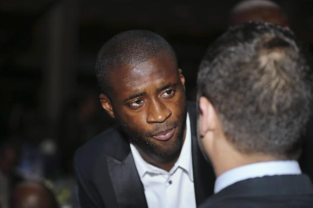 Toure speaks with a guest at the 2013 CAF Awards in Lagos