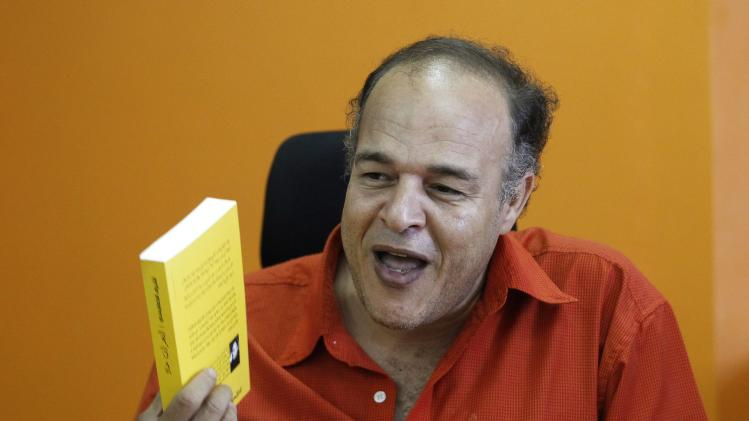 Egyptian novelist Ashraf Al-Khamaisi speaks during an interview in Cairo