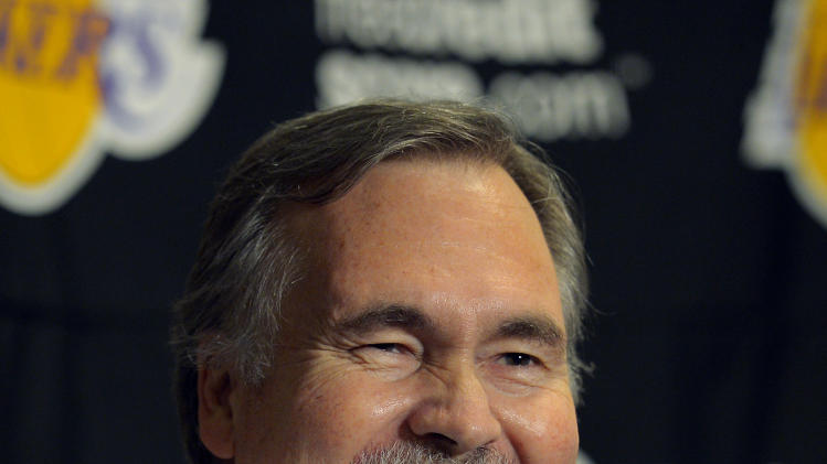 Los Angeles Lakers head coach Mike D'Antoni smiles during a news conference before their NBA basketball game against the Houston Rockets, Sunday, Nov. 18, 2012, in Los Angeles. (AP Photo/Mark J. Terrill)