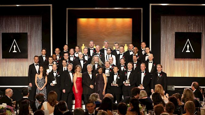People stand for the group photo at the Scientific and Technical Awards Ceremony at the Beverly Wilshire Hotel in Beverly Hills