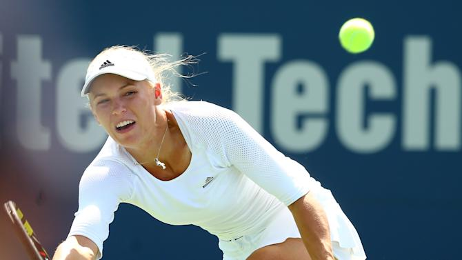 Tennis - Four-time winner Wozniacki ousted at New Haven
