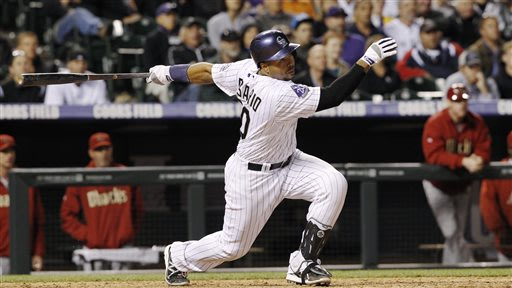 Colorado Rockies' Wilin Rosario follows the flight of his RBI single to drive in the winning run against the Arizona Diamondbacks in the 10th inning of the Rockies' 5-4 victory in a baseball game in D