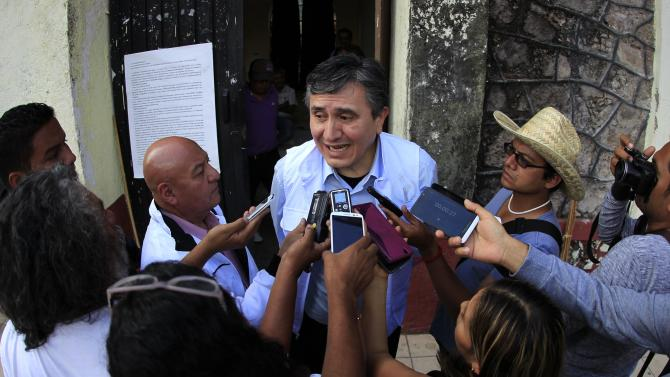 President of the National Human Rights Commission (CNDH) Luis Raul Gonzalez Perez speaks to the media after a meeting with the relatives of the 43 missing students in Guerrero