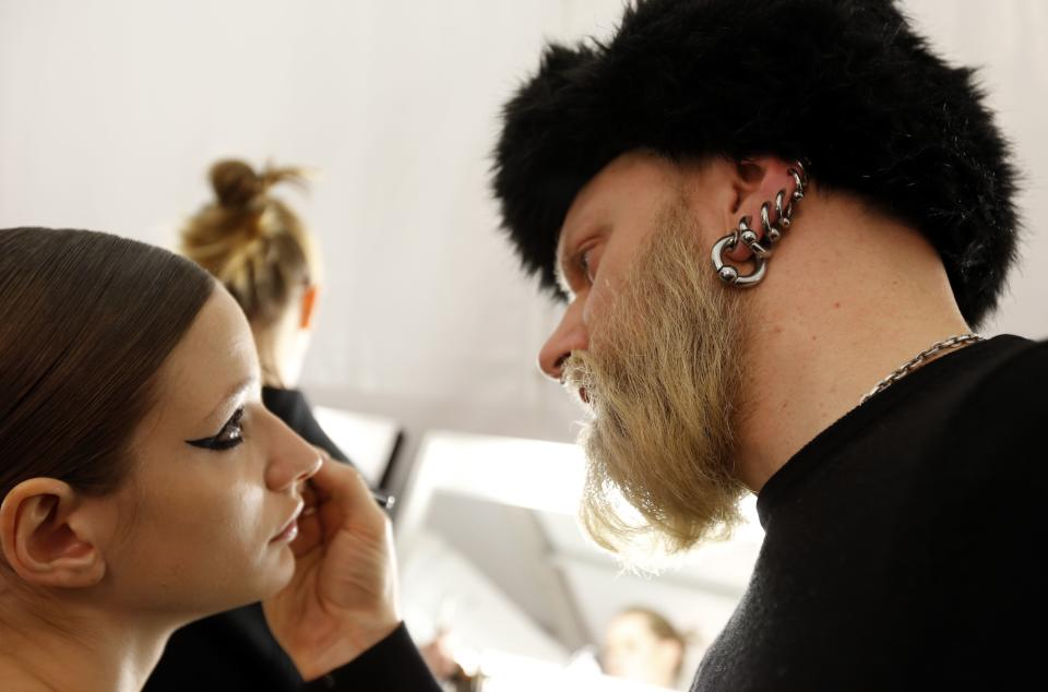 A model has her makeup done backstage before the Monique Lhuillier Fall 2013 collection is modeled during Fashion Week, Saturday, Feb. 9, 2013 in New York.  (AP Photo/Jason DeCrow)