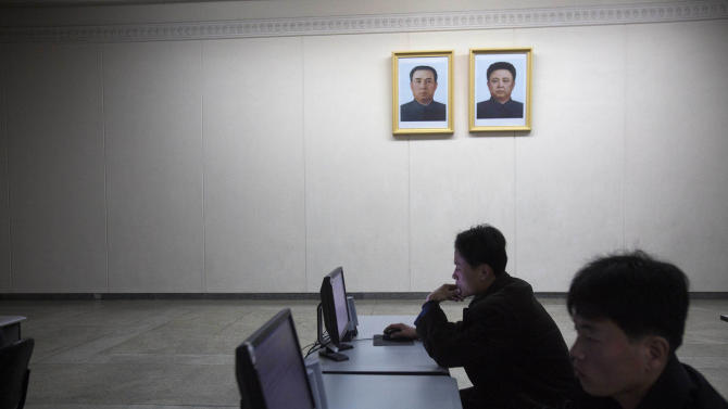 In this March 9, 2011 photo, people work on library computers at the Grand People's Study House in Pyongyang, North Korea. North Korea is undergoing a digital revolution of sorts, even as it holds some of the strictest cyberspace policies in the world. (AP Photo/David Guttenfelder)