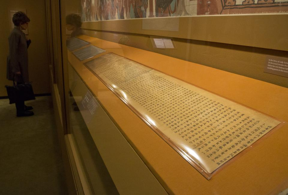 "A handwritten Buddhist scripture, from the Tang Dynasty, 618-907 AD, is displayed in ""Dunhuang: Buddhist Art at the Gateway of the Silk Road,"" at the China Institute, in New York,  Tuesday, April 24, 2013. (AP Photo/Richard Drew)"