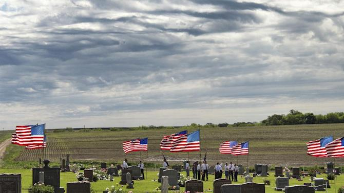 Members of the American Legion Post 367 of Virginia, Neb., gather at at the Filley Cemetery for a service on Memorial Day, Monday, May 25, 2015. Americans observe Memorial Day to remember the men and women who died while serving in the U.S. military. (Ted Kirk/The Journal-Star via AP)