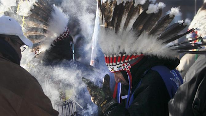 """Dakota warriors and participants received spiritual cleansing with burning sage at the event. The Dakota Wokiksuye Memorial Ride and Memorial Run culminated at Reconcilation Park in Mankato, Minn., Wednesday, Dec. 26, 2012. The annual ride commemorates the 38 + 2 Dakota warriors hanged following the Dakota War of 1862. The """"Dakota 38"""" Memorial lists the names of all the Dakota warriors hanged in 1862. (AP Photo/The Star Tribune, David Joles)"""