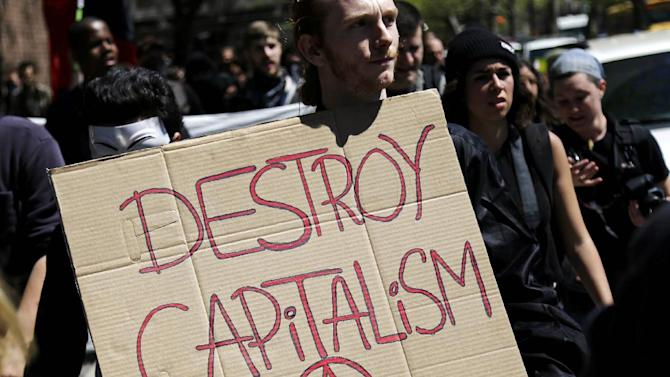 May Day protesters march in New York, Wednesday, May 1, 2013. Activists in New York City are protesting working conditions, immigration reform and other issues. (AP Photo/Seth Wenig)