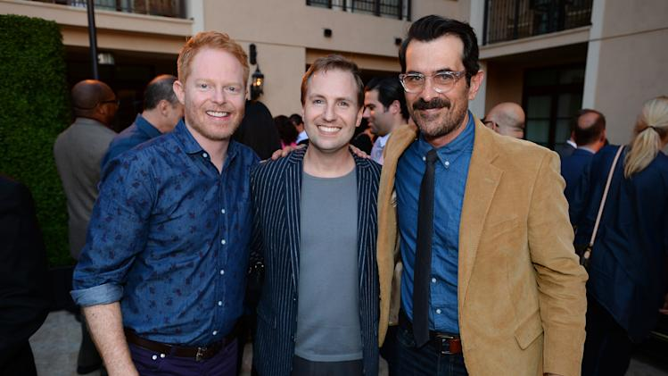 Jesse Tyler Ferguson, and from left, Maury McIntyre, Television Academy president and COO, and Ty Burrell attend the Television Academy's 66th Emmy Awards Performers Peer Group Celebration at the Montage Beverly Hills on Monday, July 28, 2014, in Beverly Hills, Calif. (Photo by Jordan Strauss/Invision for the Television Academy/AP Images)