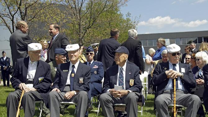 FILE - In this Wednesday, April 18, 2012 photo, four of the five surviving members of the Doolittle Raiders, front row from left: Thomas C. Griffin, David J. Thatcher, Richard E. Cole and Edward J. Saylor, sit during a reunion at the National Museum of the United States Air Force in Dayton, Ohio. Griffin, a B-25 bomber navigator in the World War II bombing raid on mainland Japan, died Tuesday, Feb. 26, 2013 in a VA nursing home at the age of 96. (AP Photo/Mark Duncan, File)