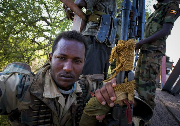 A soldier of the Somali National Army (SNA) rests on a bridge 7 km (4 miles) east of the central Somali town of Buur-Hakba