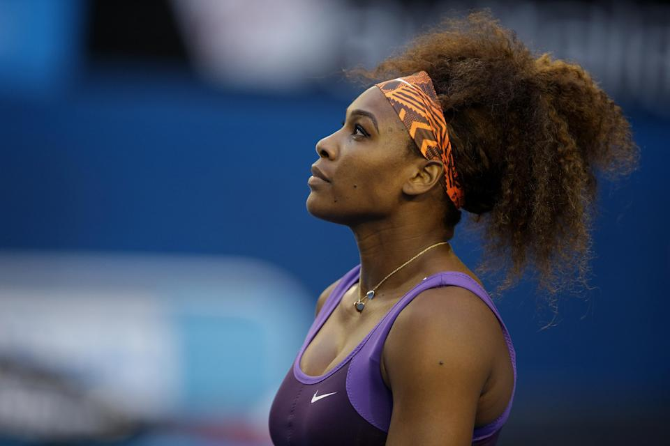 Serena Williams of the US waits for Russia's Maria Kirilenko to serve during their fourth round match at the Australian Open tennis championship in Melbourne, Australia, Monday, Jan. 21, 2013. (AP Photo/Dita Alangkara)