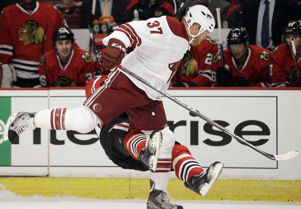Chicago Blackhawks' Marian Hossa (81) of Russia, falls down after  taking a hit from Phoenix Coyotes' Raffi Torres (37) during the first period of Game 3 of an NHL hockey Stanley Cup first-round playoff series in Chicago, Tuesday, April 17, 2012. (AP Photo/Nam Y. Huh)