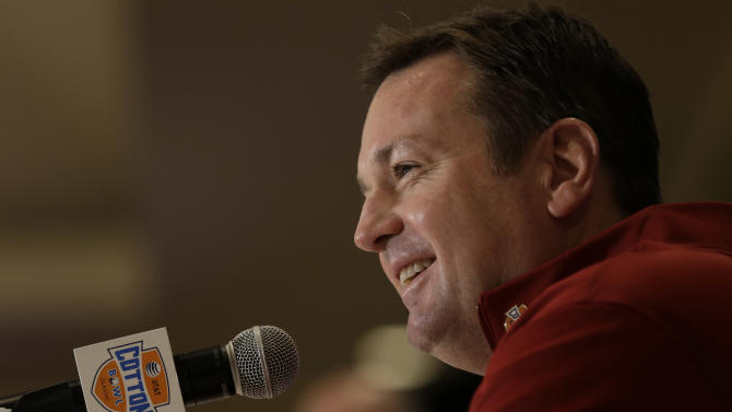 Oklahoma head coach Bob Stoops smiles as he answers a question during a news conference leading up to the Cotton Bowl NCAA college football game Wednesday, Jan. 2, 2013, in Irving, Texas. Before Texas A&M head coach Kevin Sumlin became a succesful head coach, he was on Stoops' staff at Oklahoma. Before that, they were both assistant coaches recruiting the same area. Now Sumlin takes his Texas A&M team against Stoops' Sooners in a Jan. 4th Cotton Bowl matchup of former Big 12 rivals that are both 10-2. (AP Photo/LM Otero)