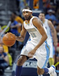 Denver Nuggets forward Corey Brewer picks up a loose ball and heads down the court against the Los Angeles Lakers in the fourth quarter of the Nuggets&#39; 113-96 victory in Game 6 of the teams&#39;  first-round NBA basketball series in Denver on Thursday, May 10, 2012. (AP Photo/David Zalubowski)